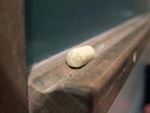 chalk on blackboard tray